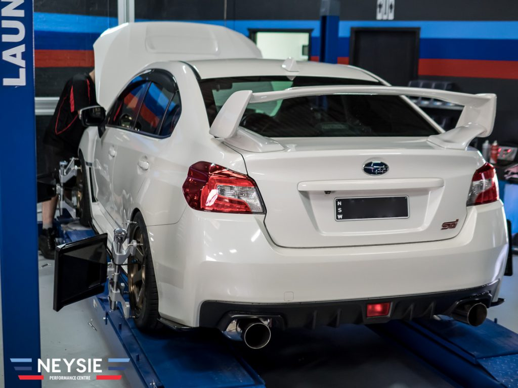 Subaru STI in mechanic workshop.