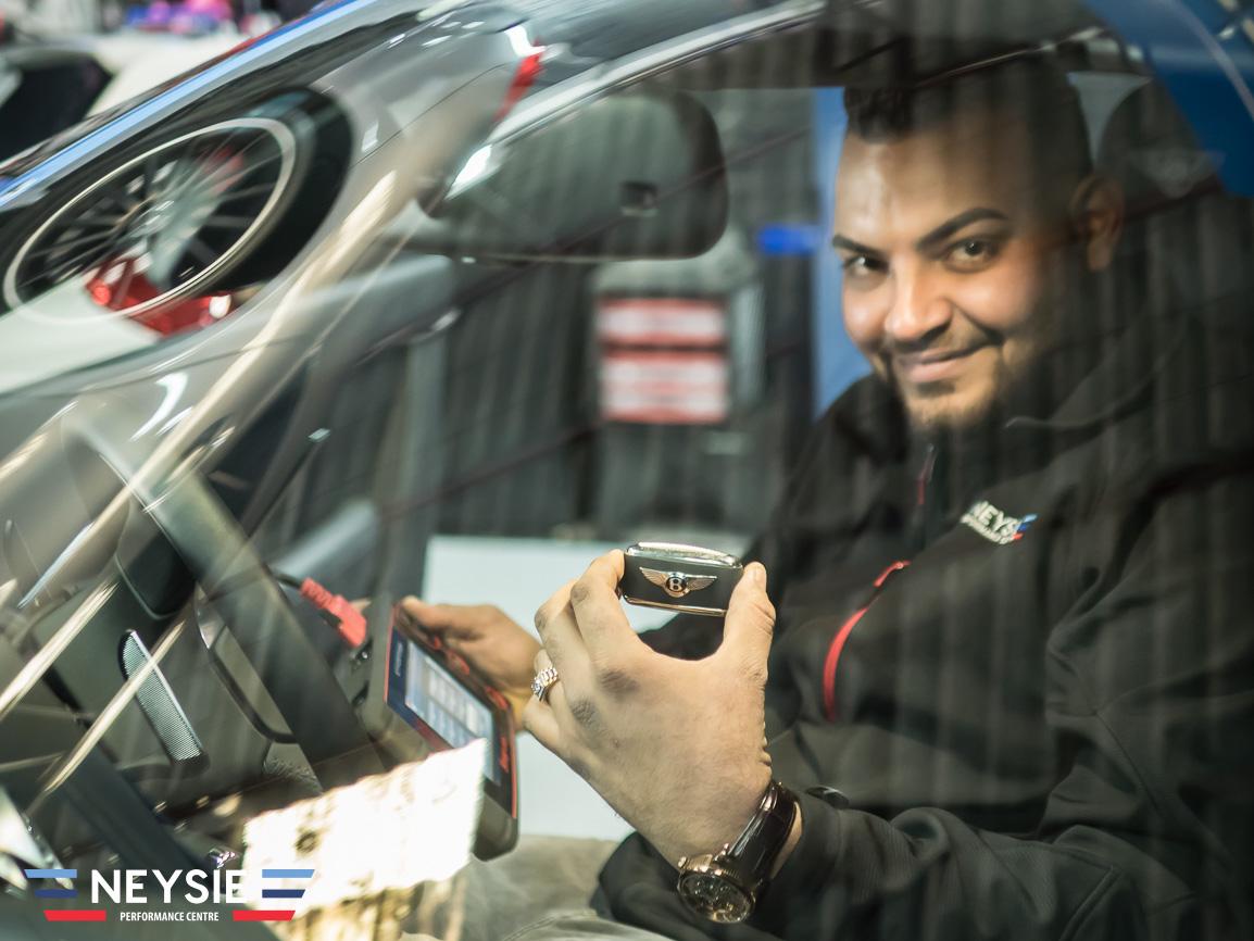 Mechanic in Bentley car.