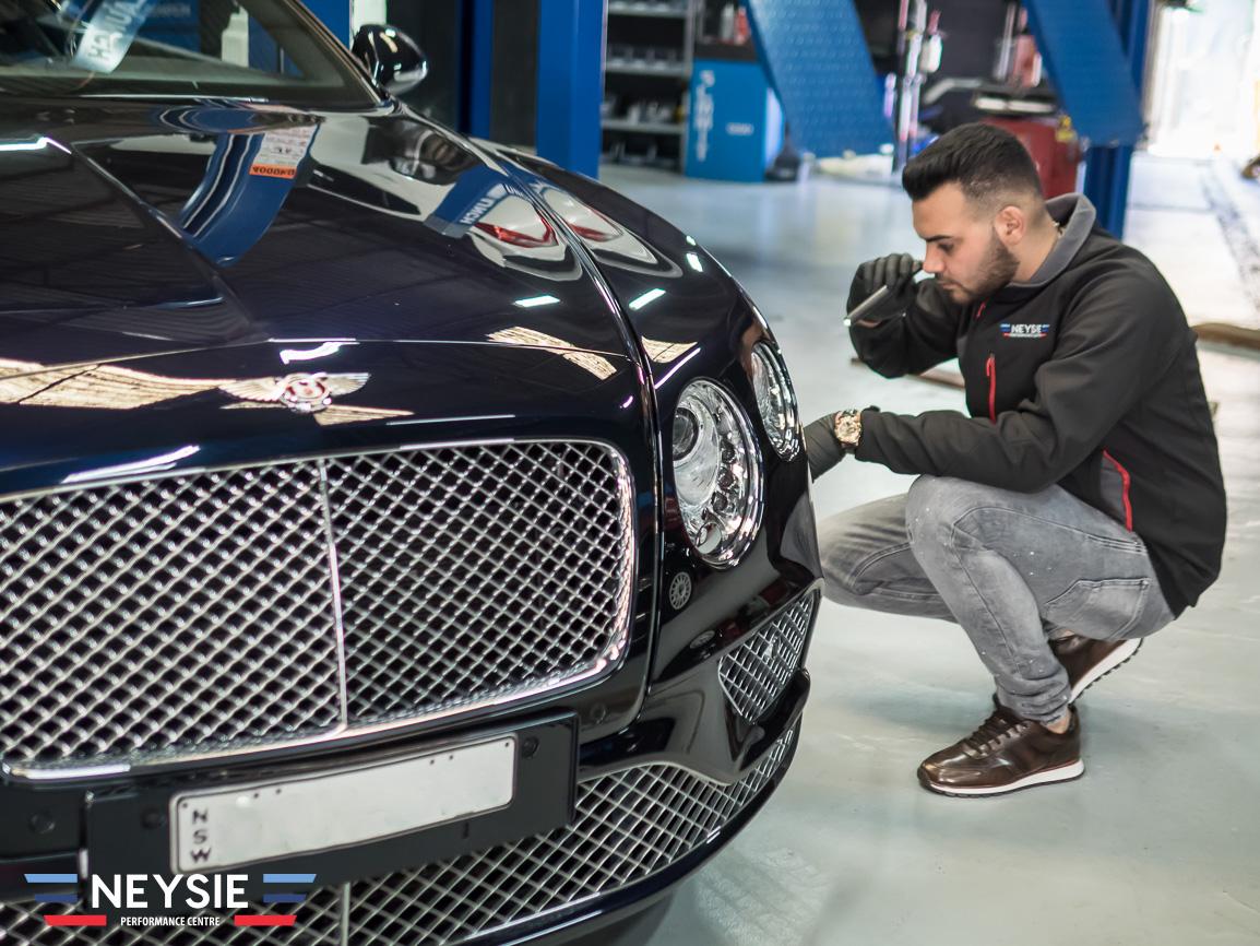 Bentley in mechanic workshop.