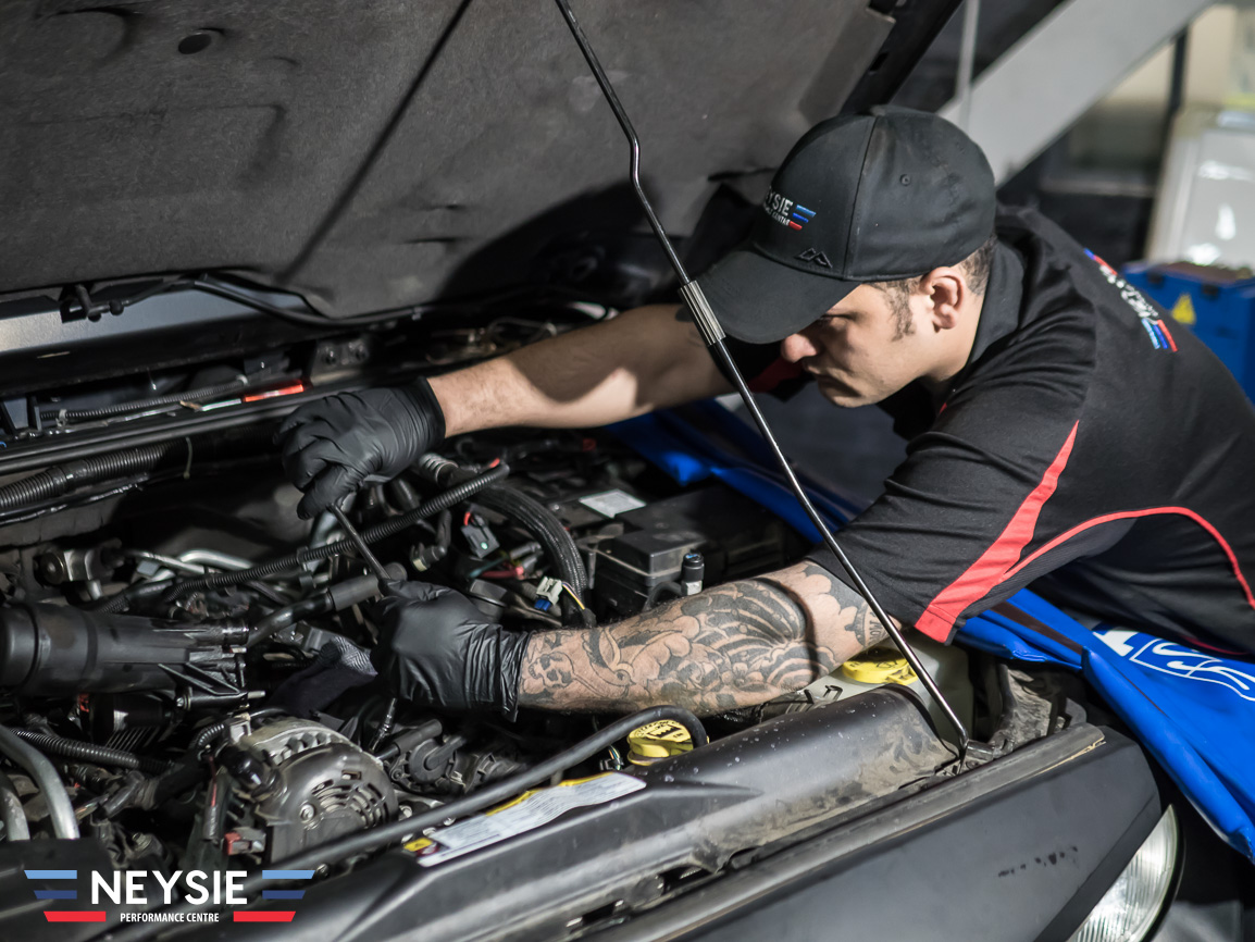 Mechanic servicing car.