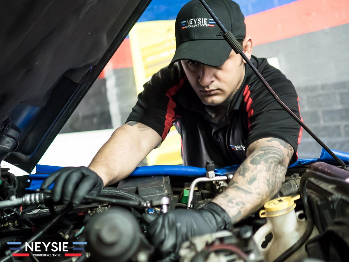 Mechanic wearing rubber gloves.